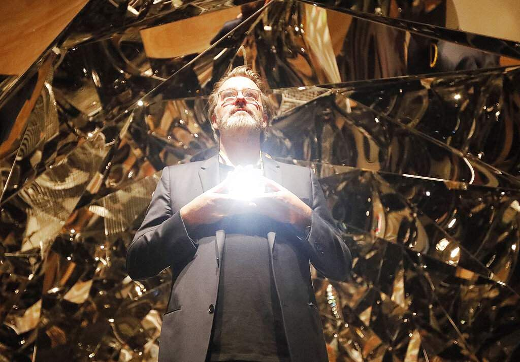 Olafur Eliasson poses at the installation Your Spiral View as part of the exhibition Olafur Eliasson: In Real Life at the Tate Modern Gallery in London. (AP Photo/Frank Augstein)