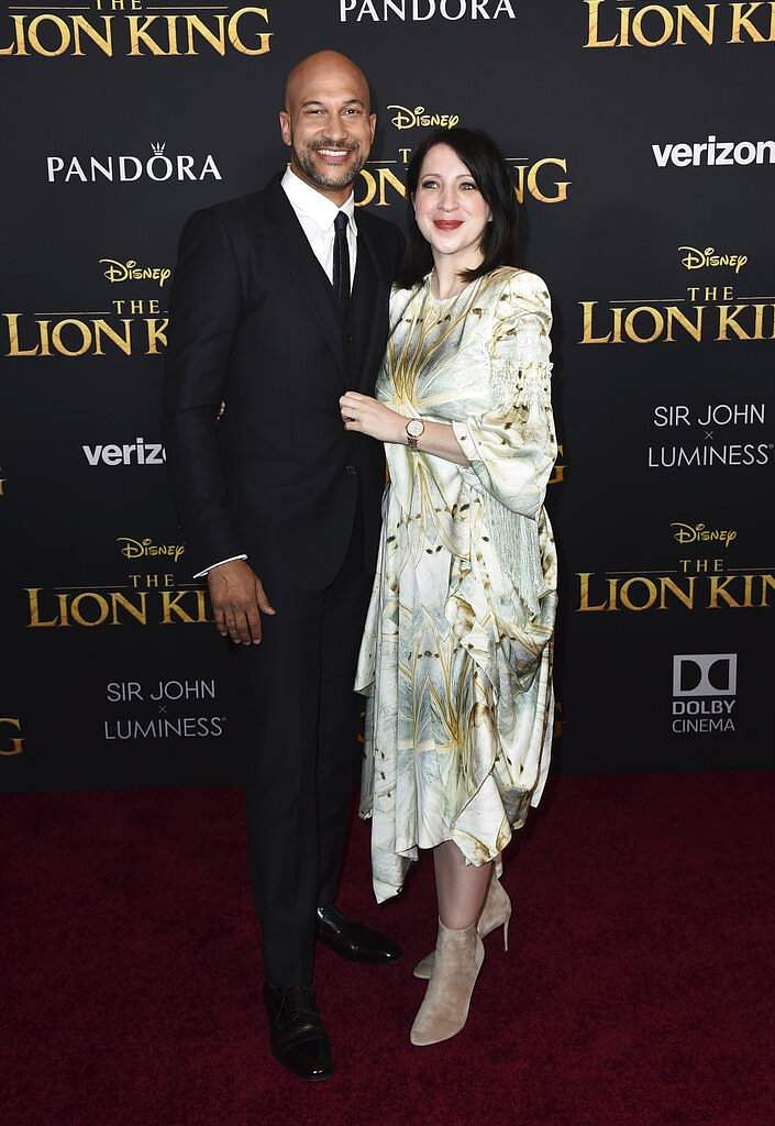 Keegan-Michael Key, left, and Elisa Pugliese arrive at the world premiere of 'The Lion King' on Tuesday, July 9, 2019, at the Dolby Theatre in Los Angeles. (Photo by Jordan Strauss/Invision/AP)