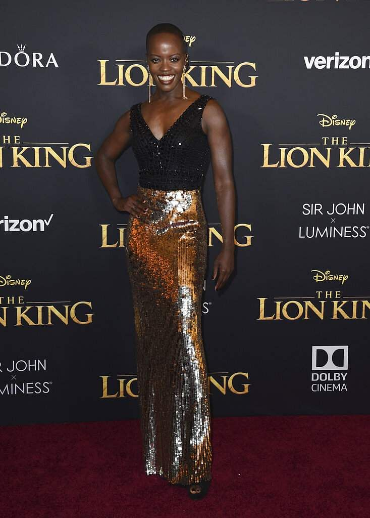 Florence Kasumba arrives at the world premiere of 'The Lion King' on Tuesday, July 9, 2019, at the Dolby Theatre in Los Angeles. (Photo by Jordan Strauss/Invision/AP)