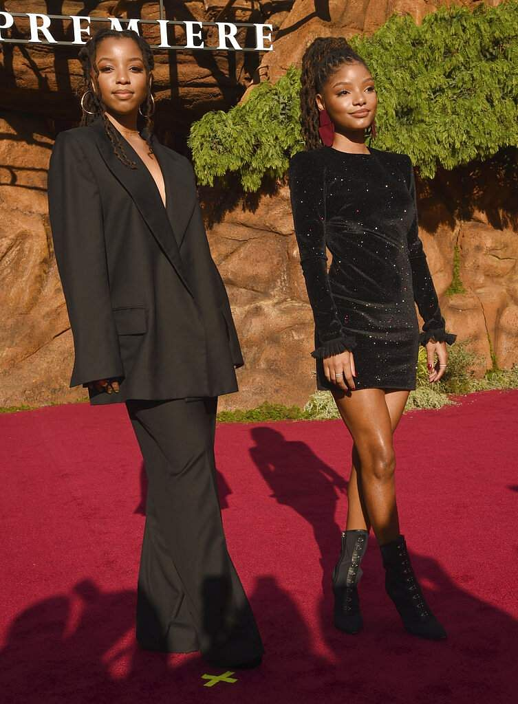Chloe Bailey and Halle Bailey, of Chloe X Halle, arrive at the world premiere of The Lion King at the Dolby Theatre in Los Angeles. (Photo by Chris Pizzello/Invision/AP)