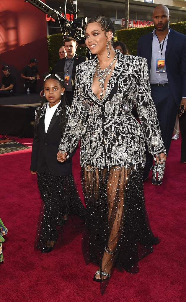 Beyonce, a cast member in 'The Lion King,' arrives with her daughter Blue Ivy at the premiere of the film, Tuesday, July 9, 2019, in Los Angeles. (Photo by Chris Pizzello/Invision/AP)