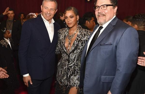 Bob Iger, chairman & CEO of The Walt Disney Company with The Lion King cast member Beyonce and director Jon Favreau at the premiere at El Capitan Theatre, LA. (Photo by Chris Pizzello/Invision/AP)