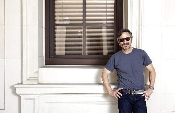 This June 11, 2019 photo shows actor, comedian and podcaster Marc Maron posing for a portrait in Los Angeles to promote his new indie comedy Sword of Trust. (Photo by Rebecca Cabage/Invision/AP)