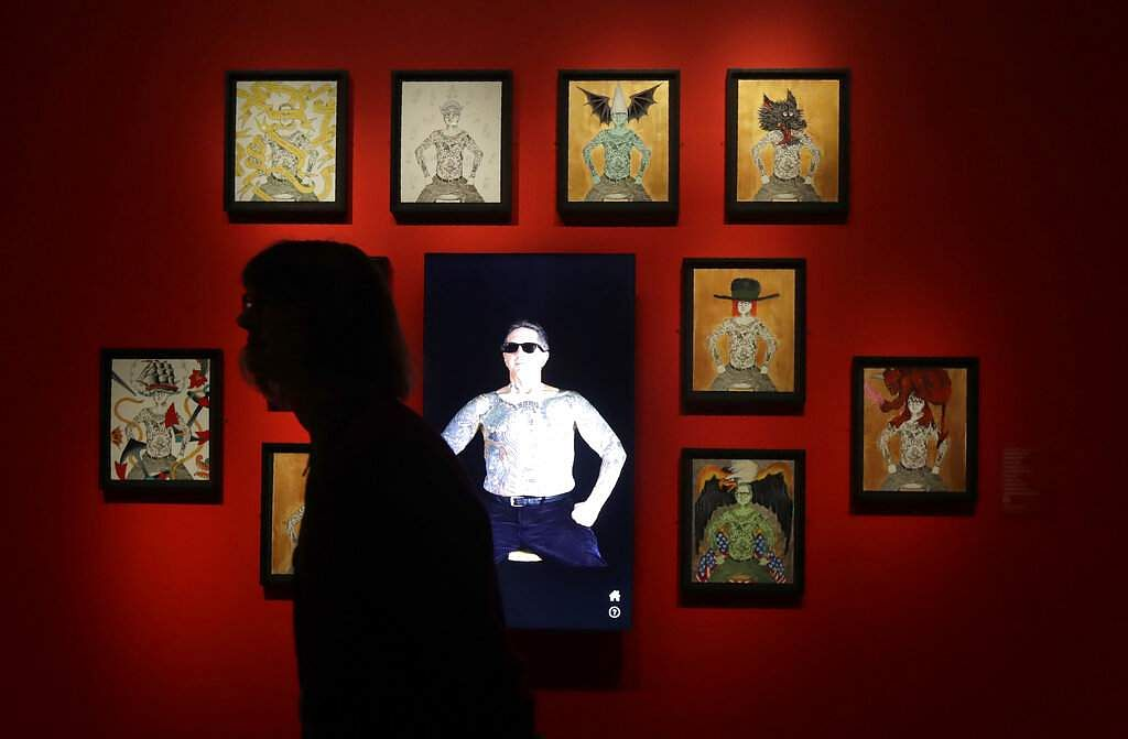 Scenes from a preview of Ed Hardy: Deeper than Skin at the de Young Museum in San Francisco, a new show that sheds light on the man as a prolific artist and tattoo pioneer. (AP Photo/Jeff Chiu)