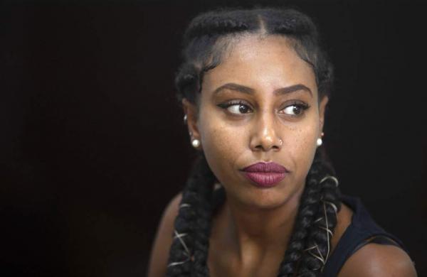 Ethiopian Israeli musician Yael Mentesnot (AP Photo/Sebastian Scheiner)