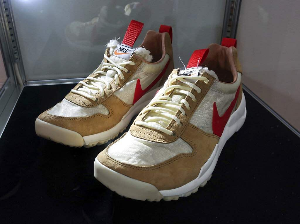 A pair of 2012 'Tom Sachs X Nikecraft Mars Yard' shoes at Sotheby's auction house in New York. Sotheby's expects two pairs to auction online for $9,000 to $12,000 (AP Photo/Ted Shaffrey)