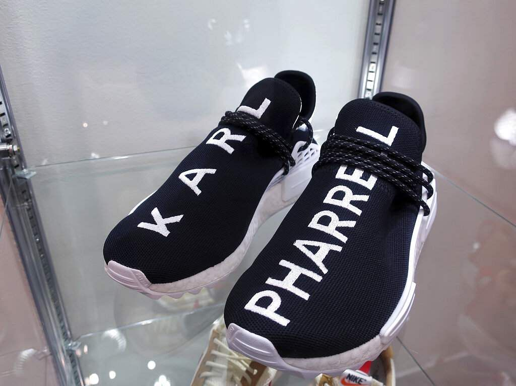 A pair of 2017 Adidas Karl Lagerfeld sneakers at Sotheby's auction house in New York. Sotheby's expects the shoes to auction online for $35,000 to $50,000 (AP Photo/Ted Shaffrey)