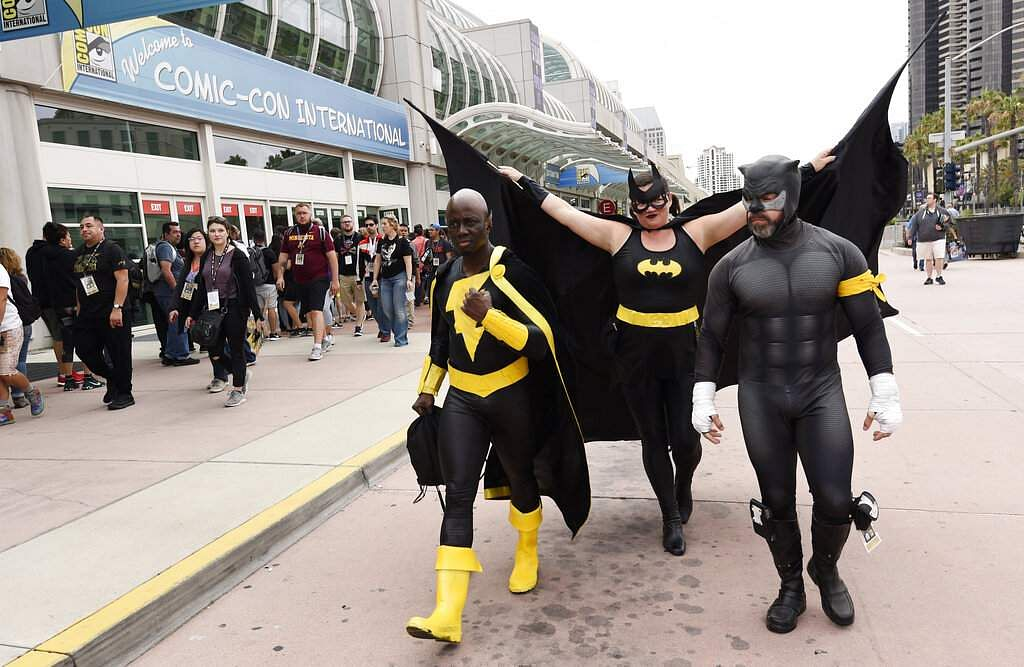 Jay Acey of New York City, dressed as DC Comics character Black Adam, Faeren Adams dressed as Batgirl and Derek Shackleton dressed as DC Comics character Wildcat. (Photo by Chris Pizzello/Invision/AP)