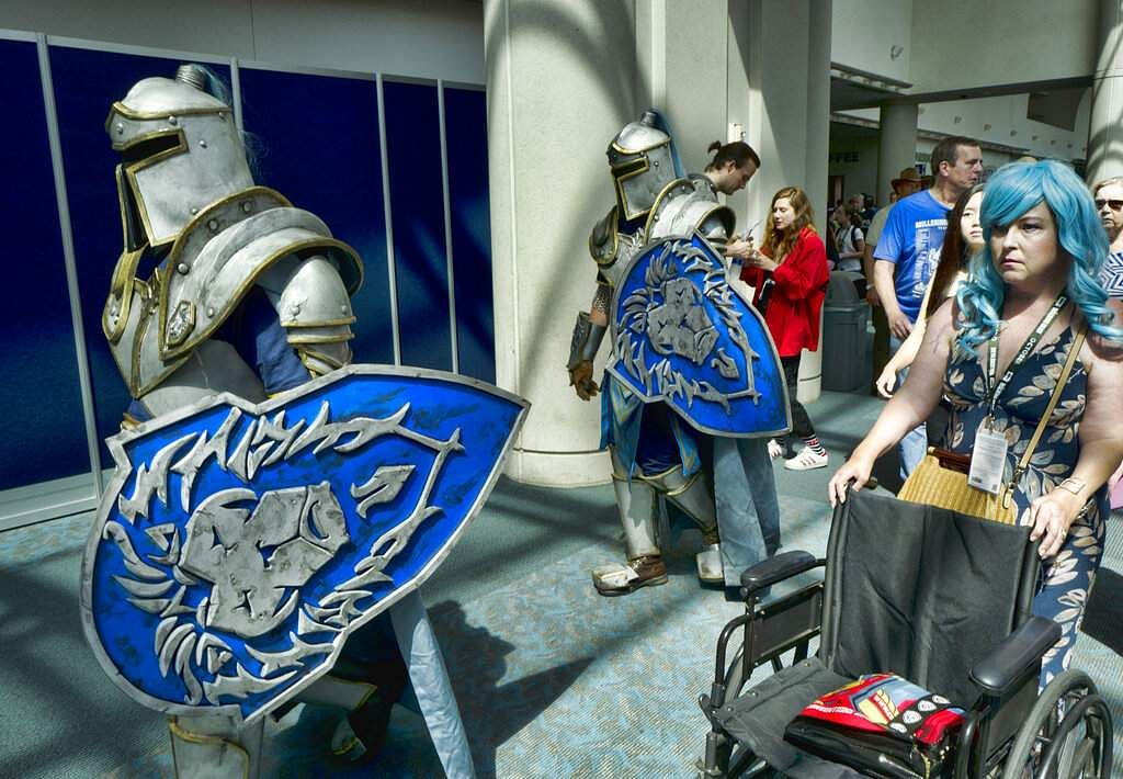 Michael Mijerark and Ryan Trent dress as knights from Warcraft at Comic-Con, San Diego. (AP Photo/Richard Vogel, File)