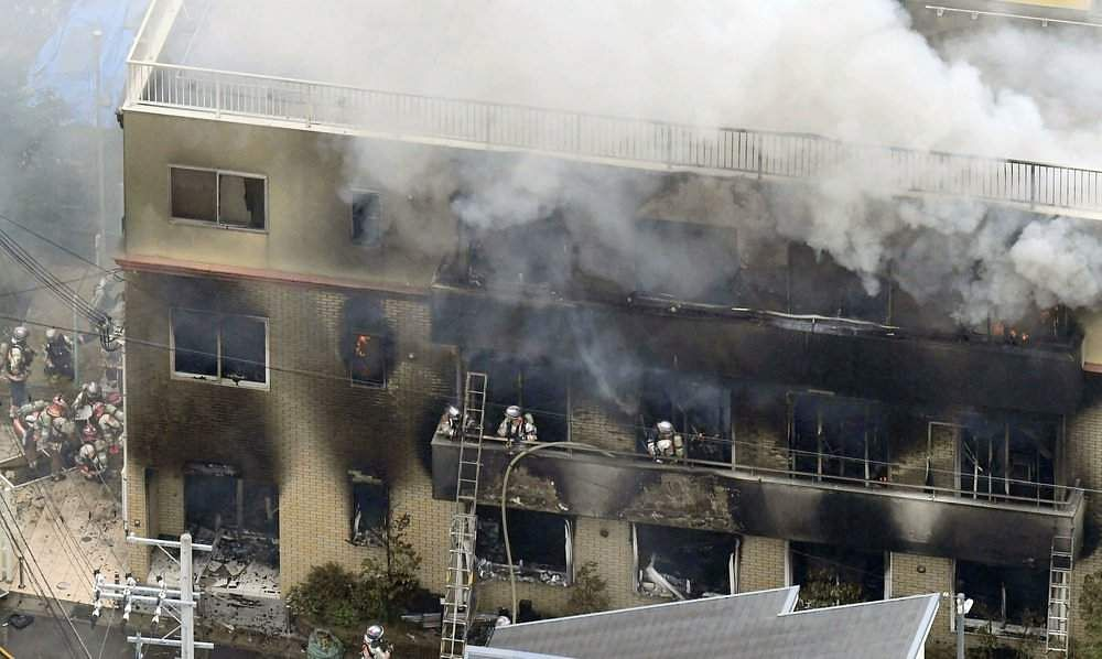 Firefighters trying to put out the fire at the studio