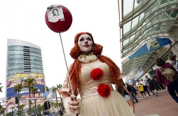 Ana Niebla of San Diego models her own Princess Pennywise outfit before Preview Night of the 2019 Comic-Con International: San Diego. (Photo by Chris Pizzello/Invision/AP)