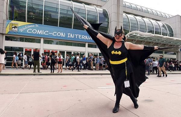 Faeren Adams dressed as Batgirl, strikes a pose outside the San Diego Convention Center at the 2019 Comic-Con International: San Diego. (Photo by Chris Pizzello/Invision/AP)
