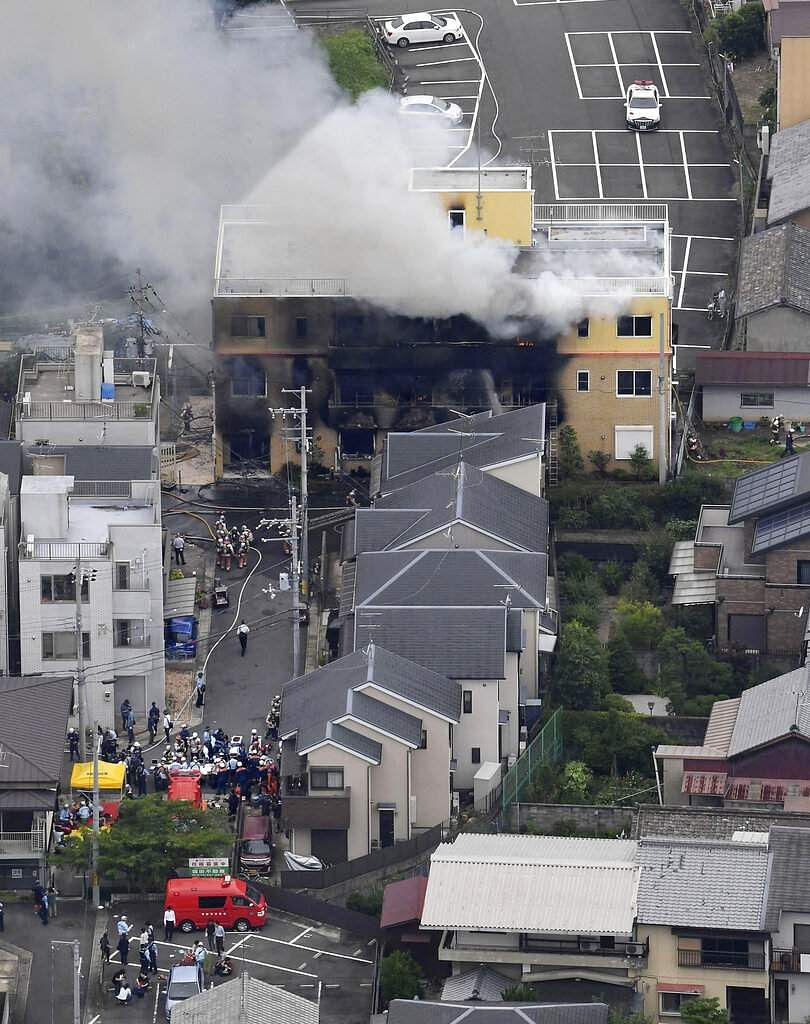 Smoke billows from a three-story building of Kyoto Animation in a fire in Kyoto, western Japan. (Kyodo News via AP)