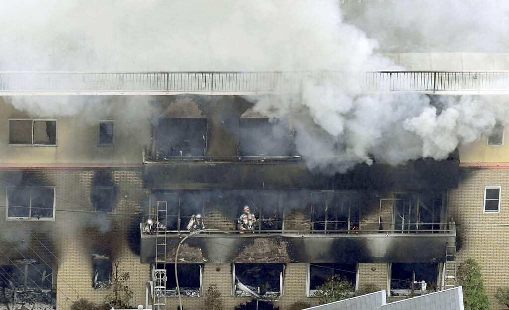 July 18, 2019, file photo: Firefighters work as smoke billows from a three-story building of Kyoto Animation in a fire in Kyoto, western Japan. (Kyodo News via AP, File)