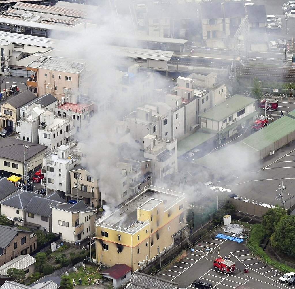 Smoke billows from a Kyoto Animation building, in Kyoto, western Japan, Thursday, July 18, 2019. (Kyodo News via AP)