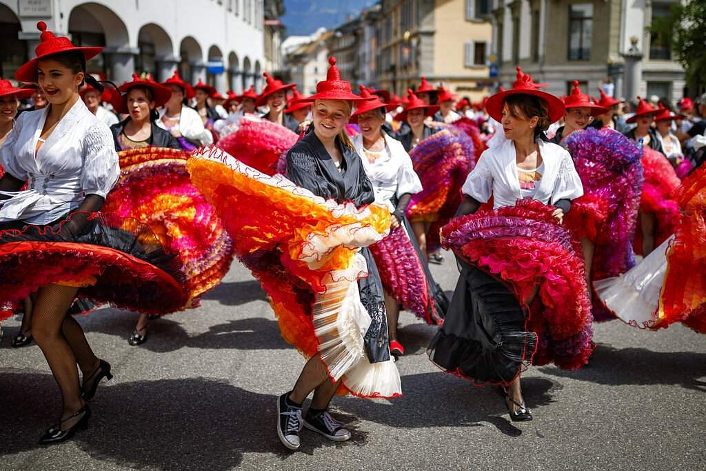 The Fete des Vignerons (winegrowers' festival in French) in Vevey, Switzerland is hosted by a brotherhood of winegrowers since 1979, and is on until August 11. (Valentin Flauraud/Keystone via AP)