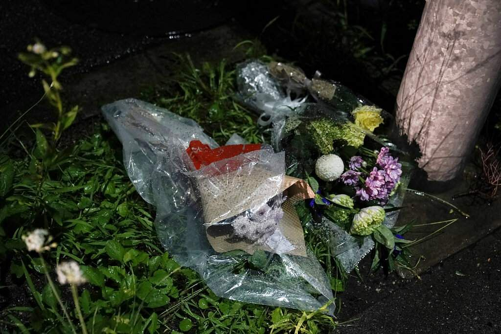 Flowers are placed near the Kyoto Animation building destroyed in an arson attack in Kyoto, Japan. (AP Photo/Jae C Hong)