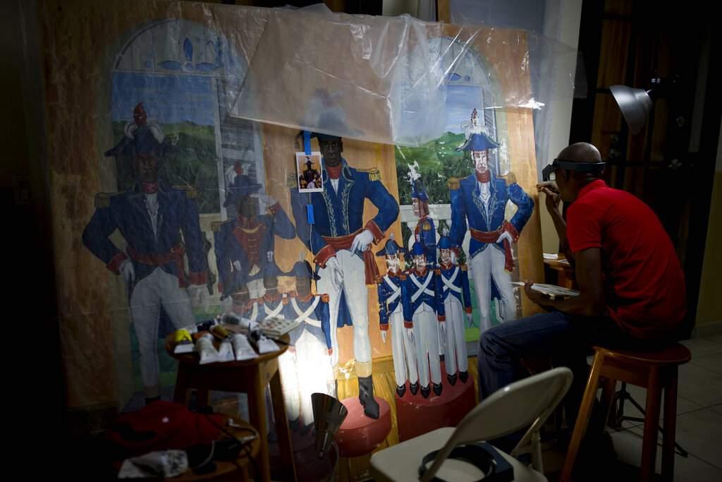 Ernst Jeudy restores a painting by Haitian artist Edouard Duval Carrie at Musée d'Art du Collège Saint Pierre, in Port-au-Prince, Haiti. (AP Photo/Dieu Nalio Chery)