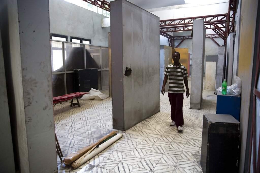 Clautaire Leveille walks inside the quake-damaged Musée d'Art du Collège Saint Pierre, in Port-au-Prince. The 2010 quake devastated many museums and galleries across Haiti. (AP Photo/Dieu Nalio Chery)
