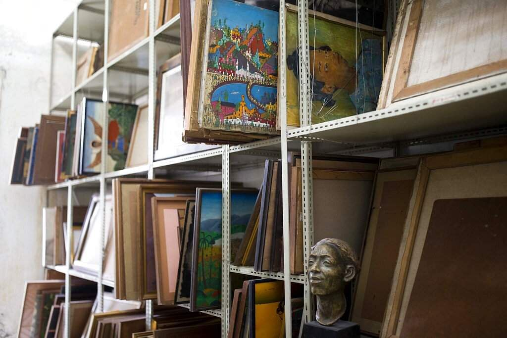 Paintings in storage at Musée d'Art du Collège Saint Pierre, in Port-au-Prince, Haiti, nearly a decade after a magnitude 7.0 quake killed an estimated 300,000 people. (AP Photo/Dieu Nalio Chery)