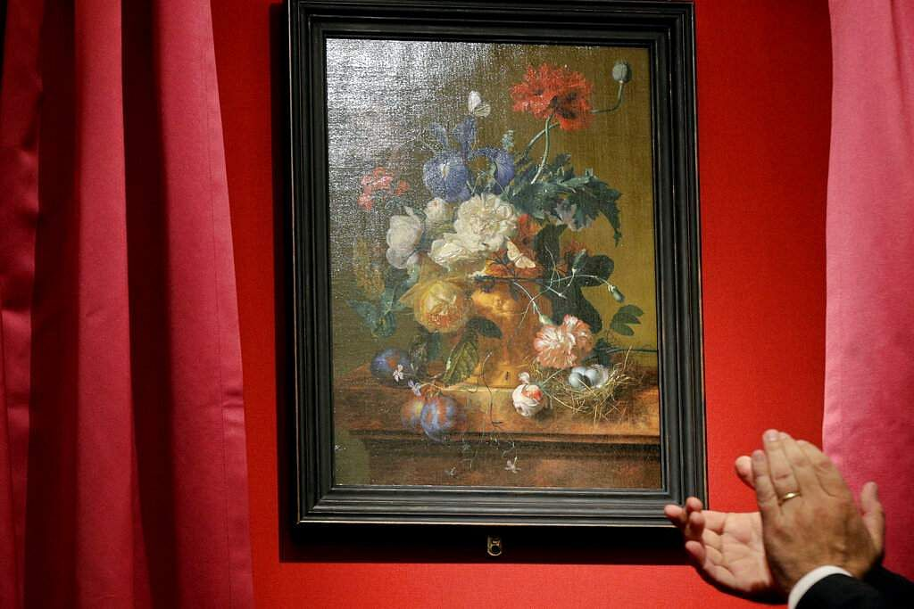 Unveiling of 'Vase of Flowers' by Jan van Huysum, at the Pitti Palace, Uffizi Galleries, in Florence, Italy. Germany returned the Dutch painting after it was stolen in WWII. (AP Photo/Gregorio Borgia)