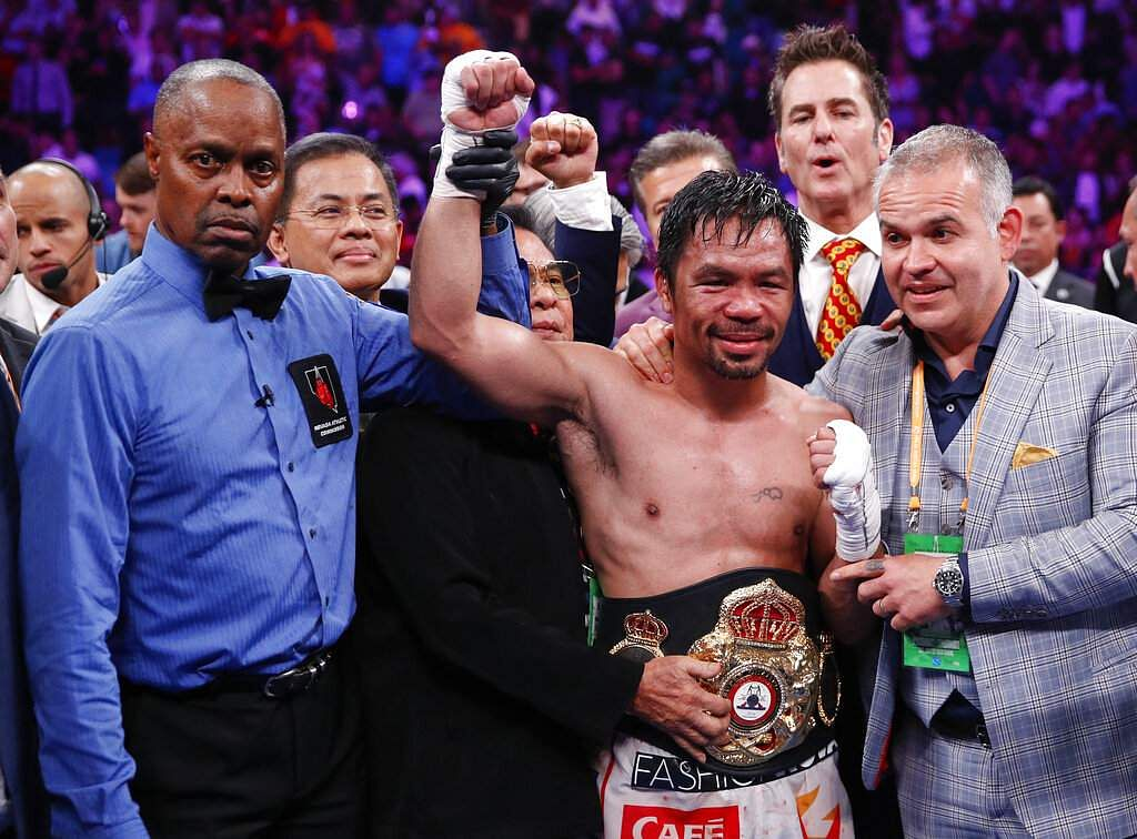Manny Pacquiao reacts as referee Kenny Bayless holds up his hand signaling his victory over Keith Thurman in a welterweight title fight Saturday, July 20, 2019, in Las Vegas. (AP Photo/John Locher)