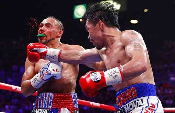 Manny Pacquiao lands a punch against Keith Thurman (AP Photo/John Locher)