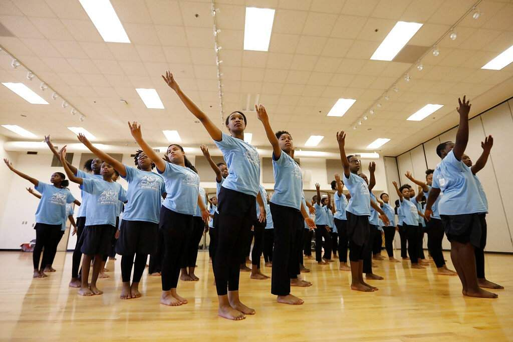Dancers rehearse a routine at Martha Ellen Stilwell School of the Arts. Campers attended dance classes with Atlanta Ballet instructors each weekday to prepare for a show. (AP Photo/Andrea Smith)