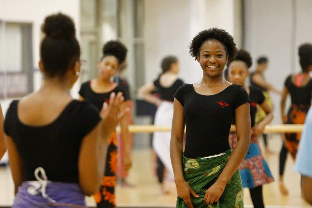 An AileyCamper smiles at a West African dance class at Martha Ellen Stilwell School of the Arts in Jonesboro, Ga. AileyCamp involves modern dance, West African and ballet. (AP Photo/Andrea Smith)