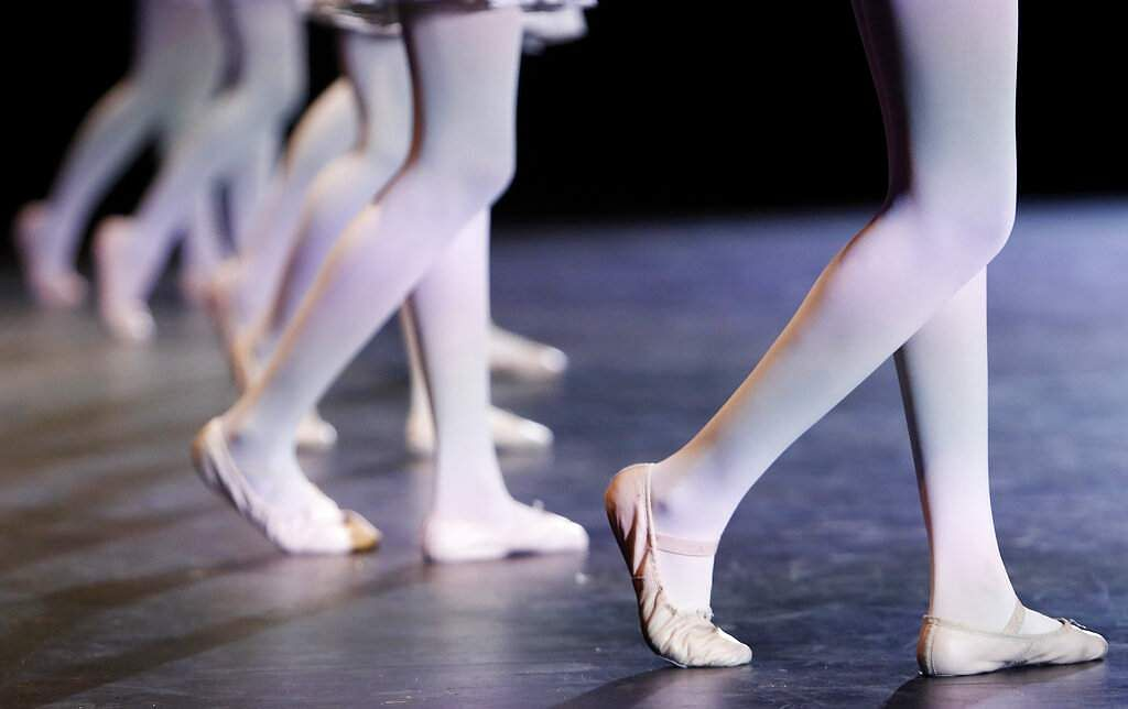 Dancers' ballet slippers are shown during a dress rehearsal at the the Clayton County Performing Arts Center in Jonesboro, Ga. (AP Photo/Andrea Smith)