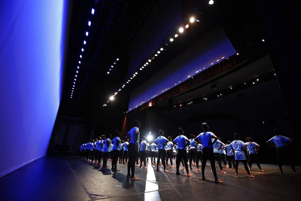 AileyCampers stand ready for rehearsal at the Clayton County Performing Arts Center in Jonesboro, Ga. Each AileyCamp accepts about 100 middle schoolers. (AP Photo/Andrea Smith)