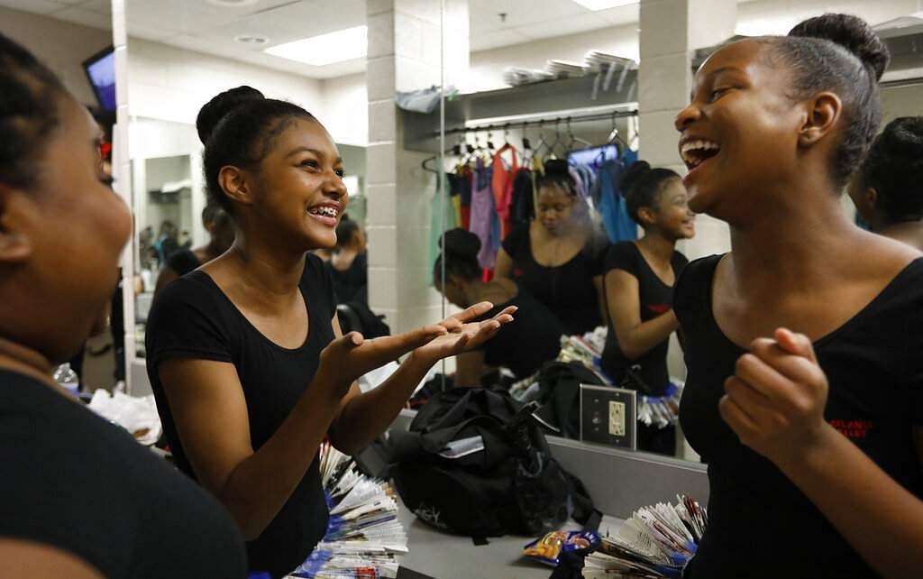 AileyCampers laugh while waiting in their dressing room before a performance at the Clayton County Performing Arts Center in Jonesboro, Ga. (AP Photo/Andrea Smith)
