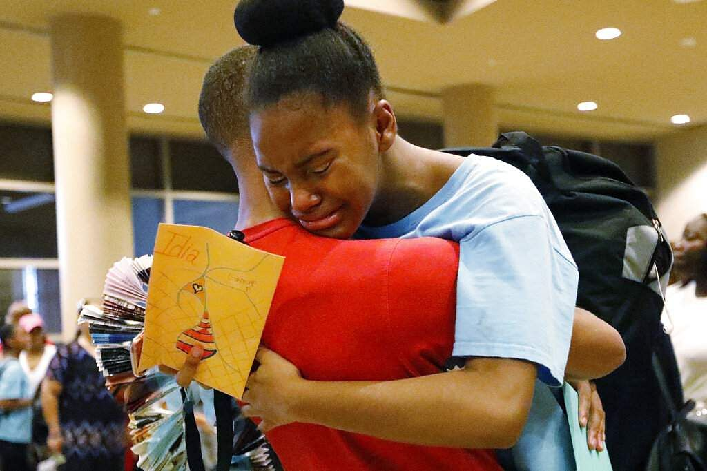 Idia Enadeghe after her last performance at the Clayton County Performing Arts Center. She received her third full-tuition scholarship to train with Atlanta Ballet for a year. (AP Photo/Andrea Smith)