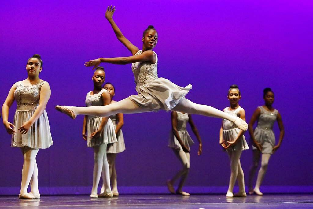 A dancer leaps across the stage during a ballet routine at the Clayton County Performing Arts Center in Jonesboro, Ga. (AP Photo/Andrea Smith)