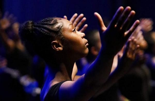 An AileyCamper rehearses the opening routine for a performance later at the Clayton County Performing Arts Center in Jonesboro, Ga. Some dancers never received training before. (AP Photo/Andrea Smith)