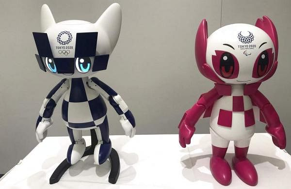 Robots of Olympics mascots Miraitowa and Paralympics Someity revealed at Toyota Motor Corp. HQ in Tokyo. (AP Photo/Yuri Kageyama)