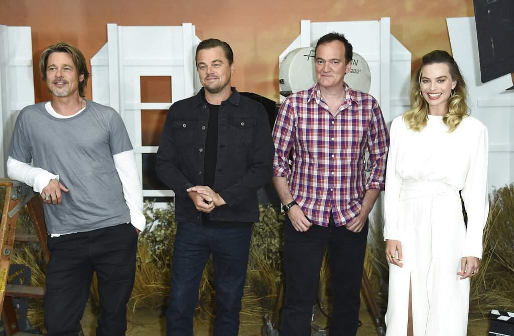 Brad Pitt, Leonardo DiCaprio, Quentin Tarantino and Margot Robbie (Photo by Jordan Strauss/Invision/AP)