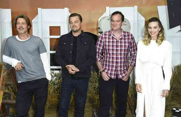 Brad Pitt, Leonardo DiCaprio, Quentin Tarantino and Margot Robbie (Photo by Jordan Strauss/Invision/AP)