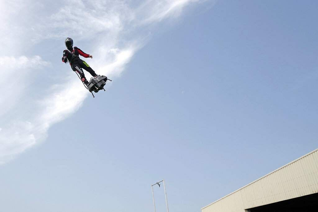 Franky Zapata 'Le Rocketman', a 40-year-old inventor, performs a training flight over the Saint Inglevert airport near Calais, Northern France. (AP Photo/Michel Spingler)