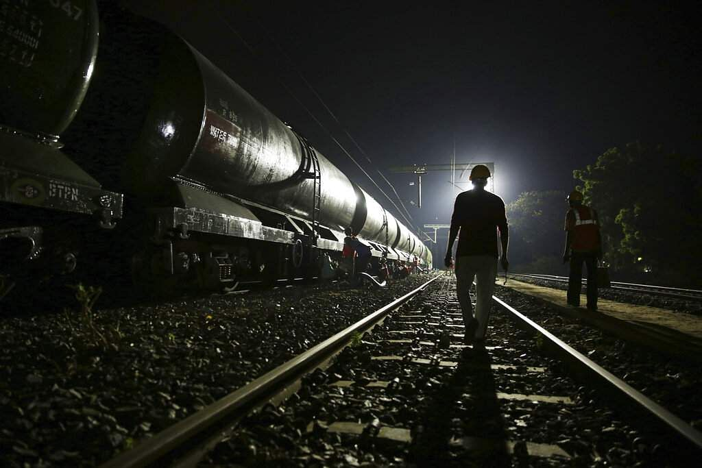 Workers decant water from a train at Villivakkam railway station in Chennai. This is a small but critical source for Chennai's water board. (AP Photo/Manish Swarup)