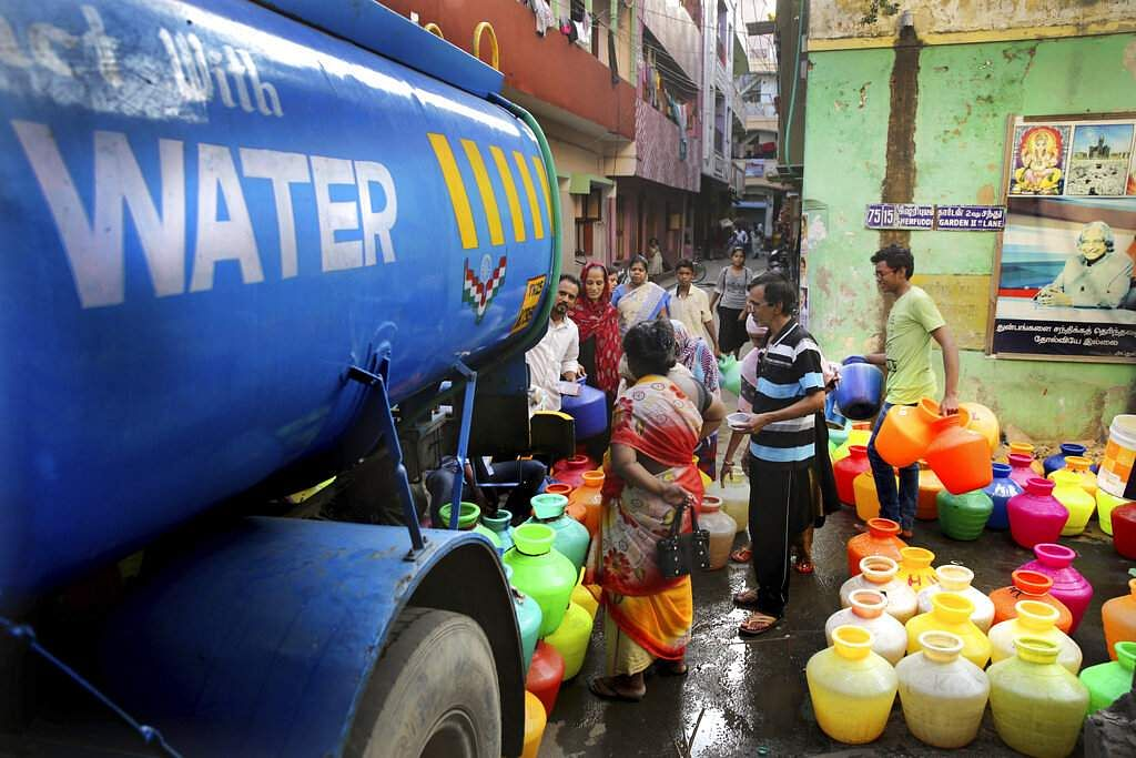 People fill drinking water from a water tanker truck in Chennai. (AP Photo/Manish Swarup)