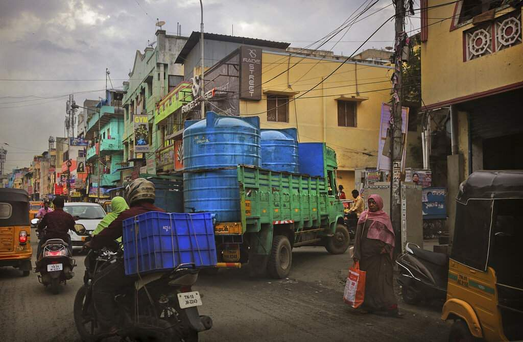 A water truck carrying drinking water arrives at a locality in Chennai. (AP Photo/Manish Swarup)