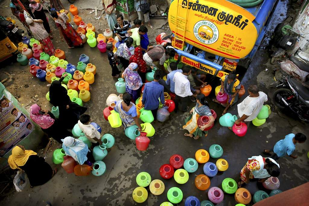 Residents fill drinking water from a truck in Chennai. (AP Photo/Manish Swarup)