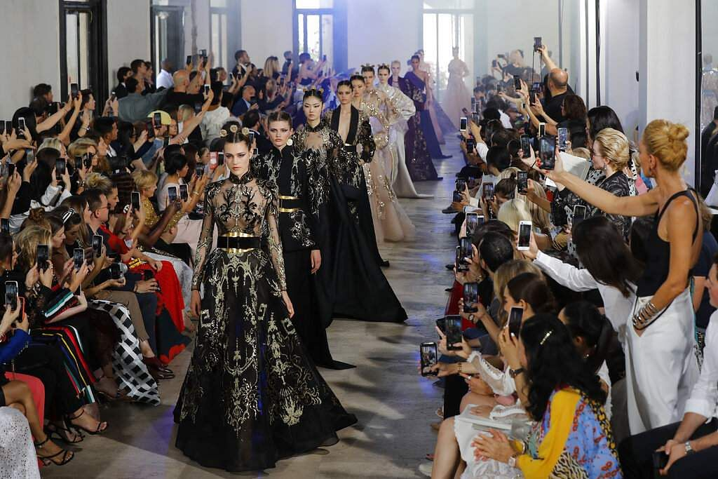 Models wear creations for Elie Saab Haute Couture Fall-Winter 2019-2020 fashion collection presented, Wednesday, July 3, 2019 in Paris. (AP Photo/Michel Euler)