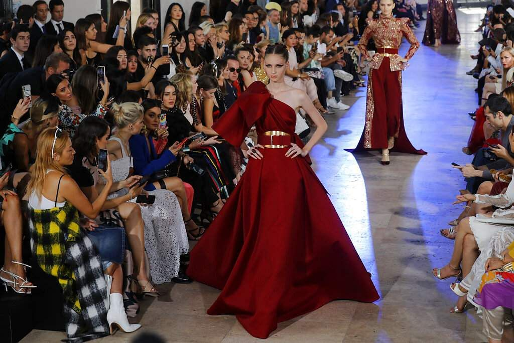A model wears a creation for Elie Saab Haute Couture Fall-Winter 2019-2020 fashion collection presented, Wednesday, July 3, 2019 in Paris. (AP Photo/Michel Euler)