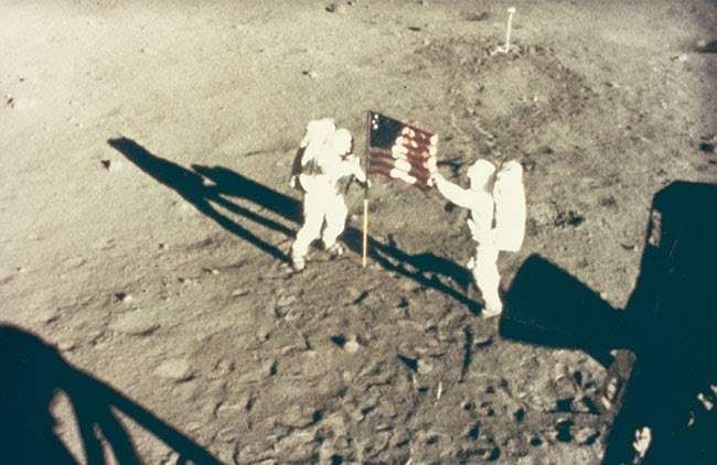 NASA's Neil Armstrong and Buzz Aldrin deploy US flag on the Moon, July 20, 1969 (Credit: National Gallery of Art, Washington, Gift of Mary and Dan Solomon)