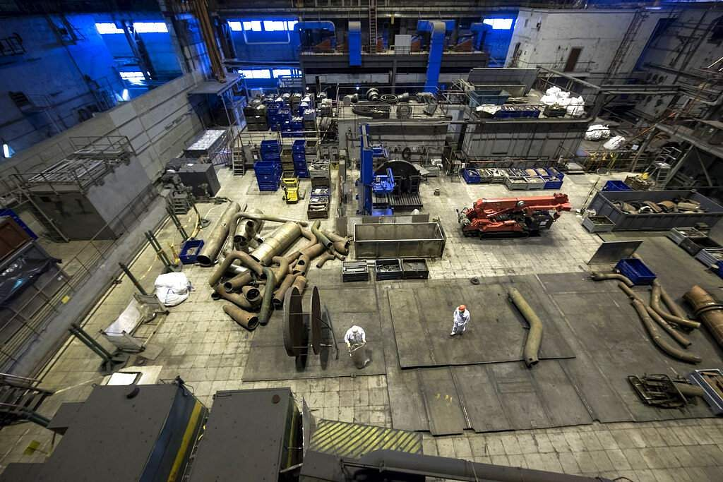 Workers at a Turbine Hall of Ignalina Nuclear Plant in Visaginas, near Vilnius, Lithuania. The HBO series Chernobyl is helping Lithuania grow as a tourist destination. (AP Photo/Mindaugas Kulbis)