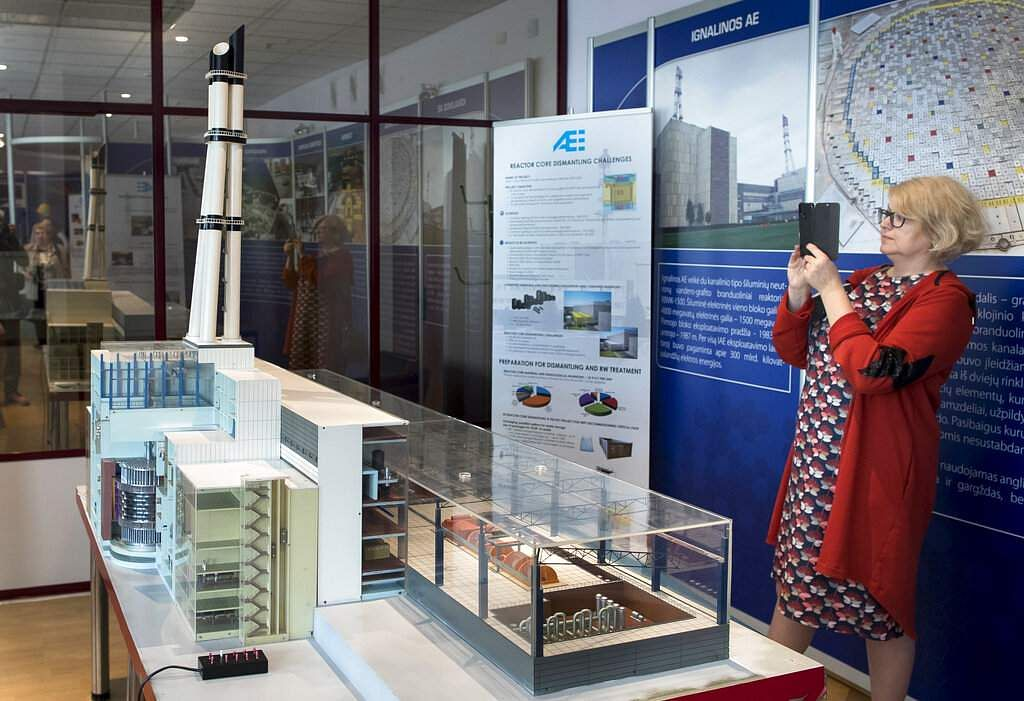 A tourist takes a picture of a model of the Ignalina nuclear power plant. The HBO series Chernobyl on Soviet-era nightmares is bringing fresh tourist interest to Lithuania. (AP Photo/Mindaugas Kulbis)