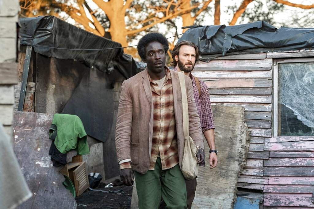 Michael Kenneth Williams and Chris Evans in The Red Sea Diving Resort (Marcos Cruz/Netflix via AP)