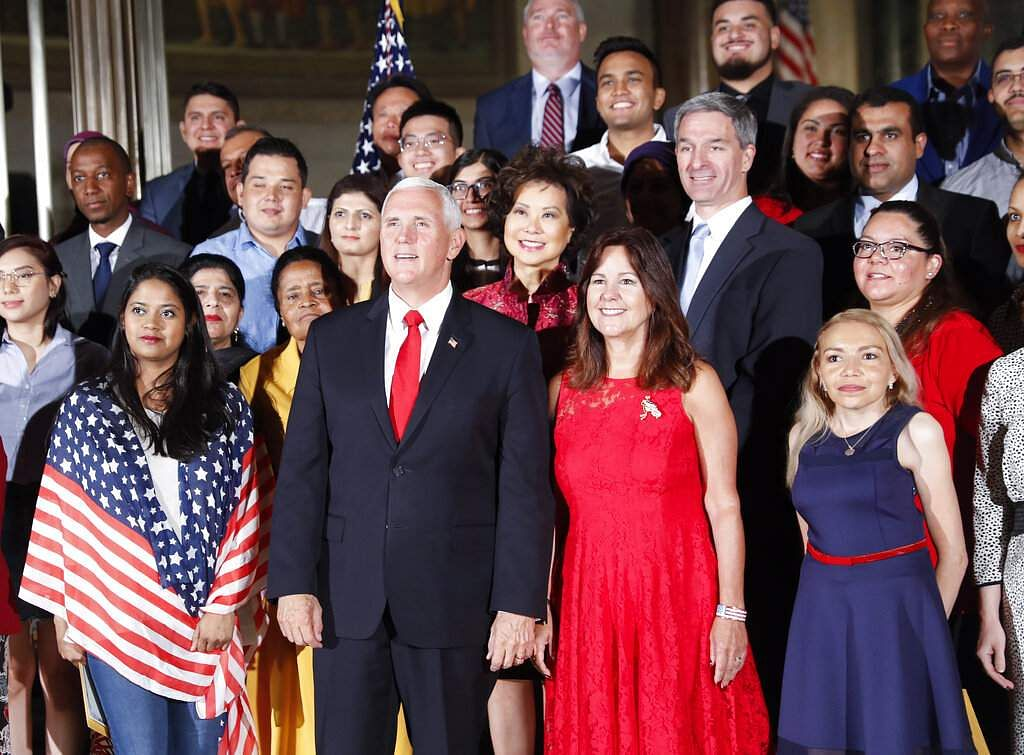 Vice President Mike Pence and wife Karen Pence pose for a group photo in celebration of Independence Day at the National Archives in Washington, July 4, 2019. (AP Photo/Pablo Martinez Monsivais)